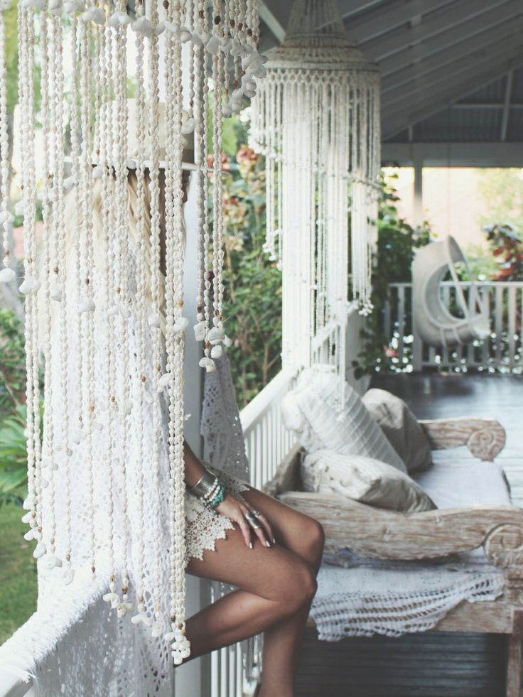 Shell Chandeliers Daybed Hanging Chair And Timber Verandah