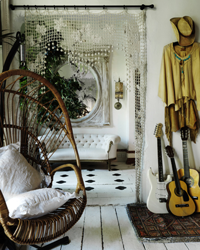 White timber interior design with cane furniture and guitars