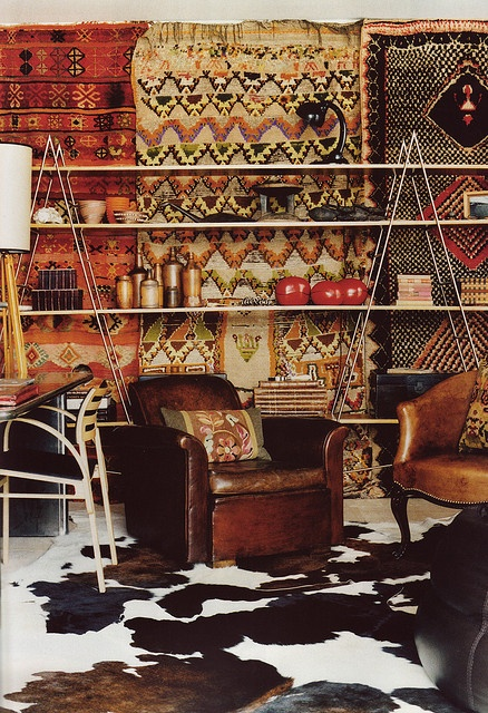 Oriental hanging rugs, cowhide rugs and leather chairs