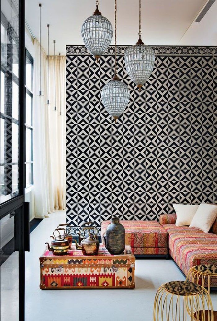 Moroccan print couch and geometric wall patterns