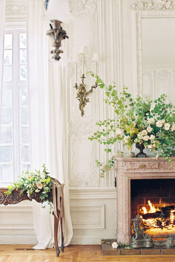 Fireplace, flowers, parquetry and engraved wood sideboard