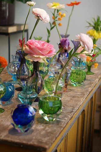 Colourful flowers and assorted vases