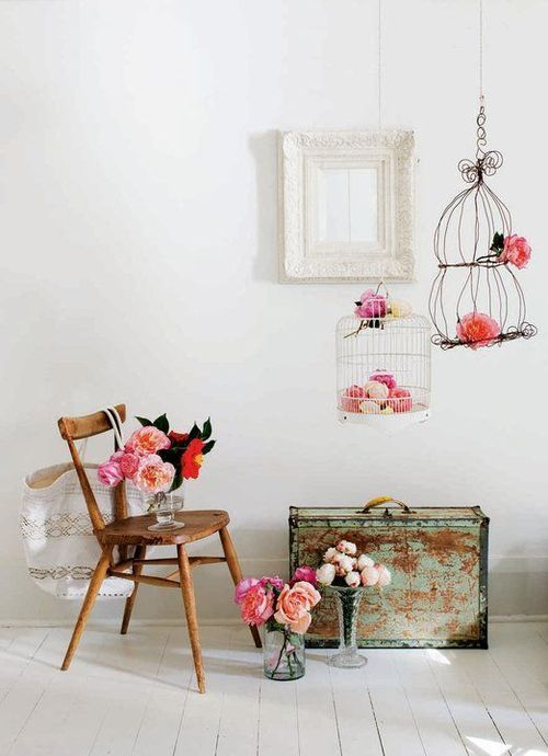 White timber space with pink roses and wire birdcages