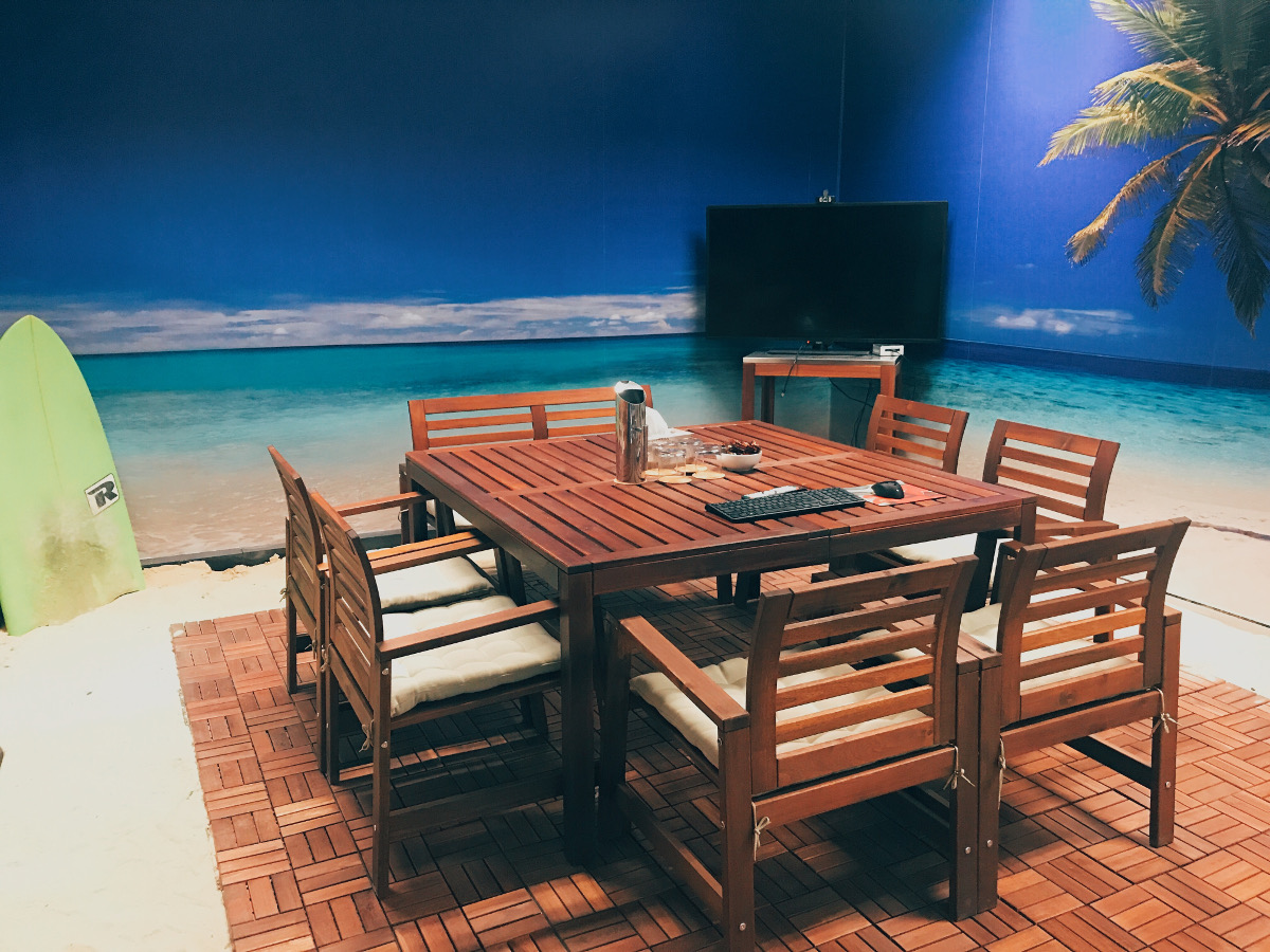 Meeting room with sand floor and beach photo background wall