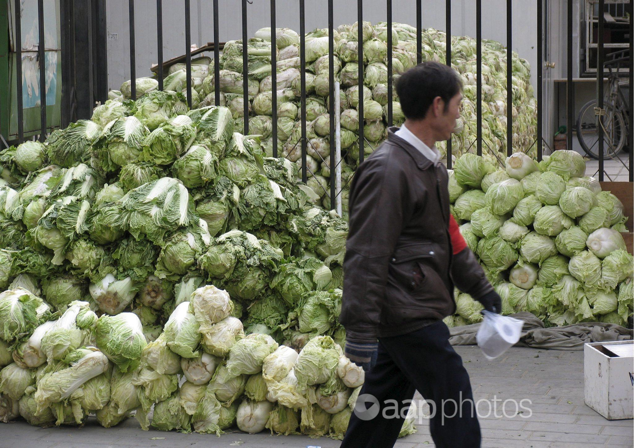 A stack of cabbages in a Beijing residential area.