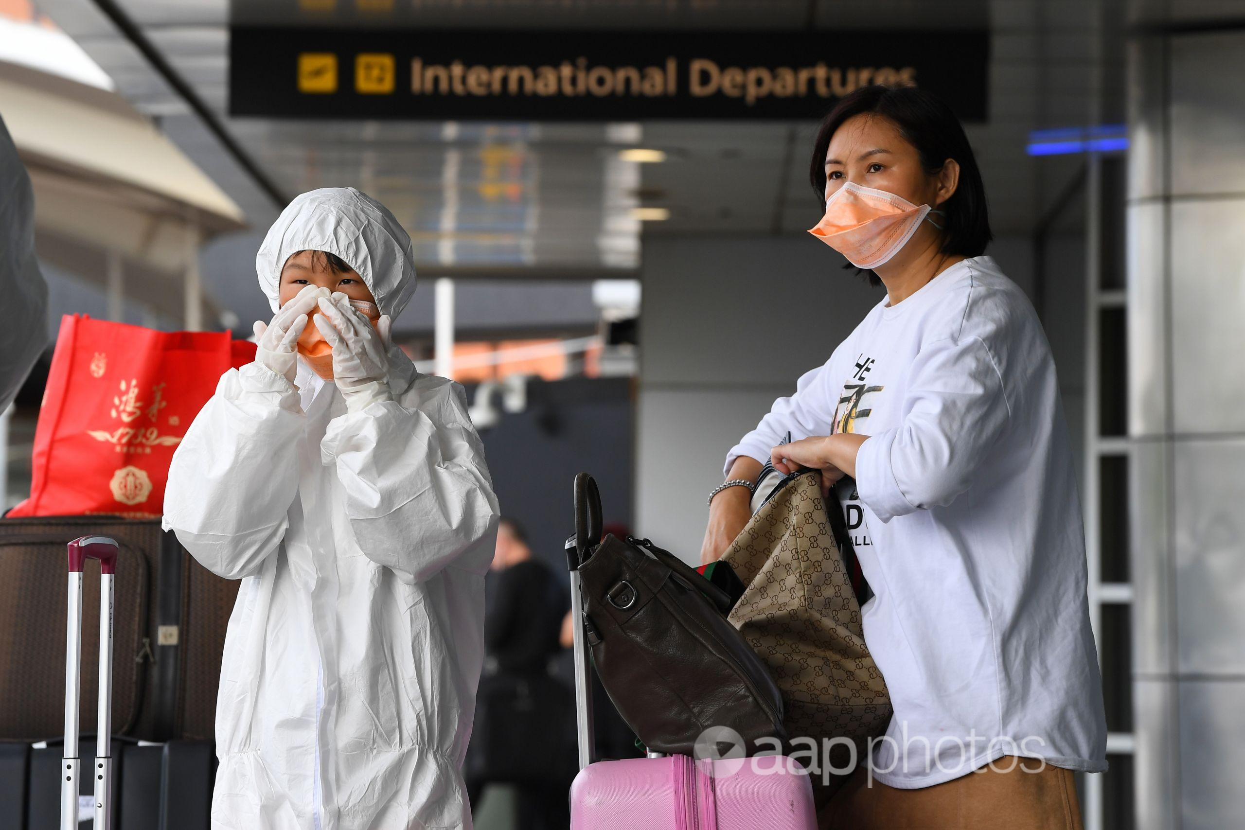 Two people wear masks to protect themselves against coronavirus.