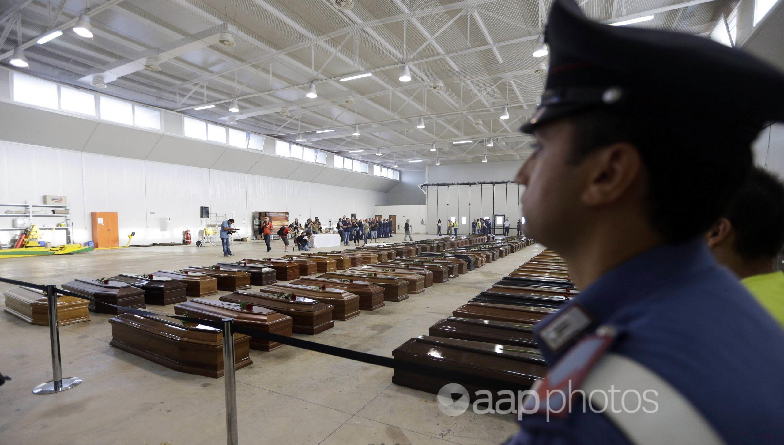 The coffins of migrants inside the hangar of Lampedusa's airport