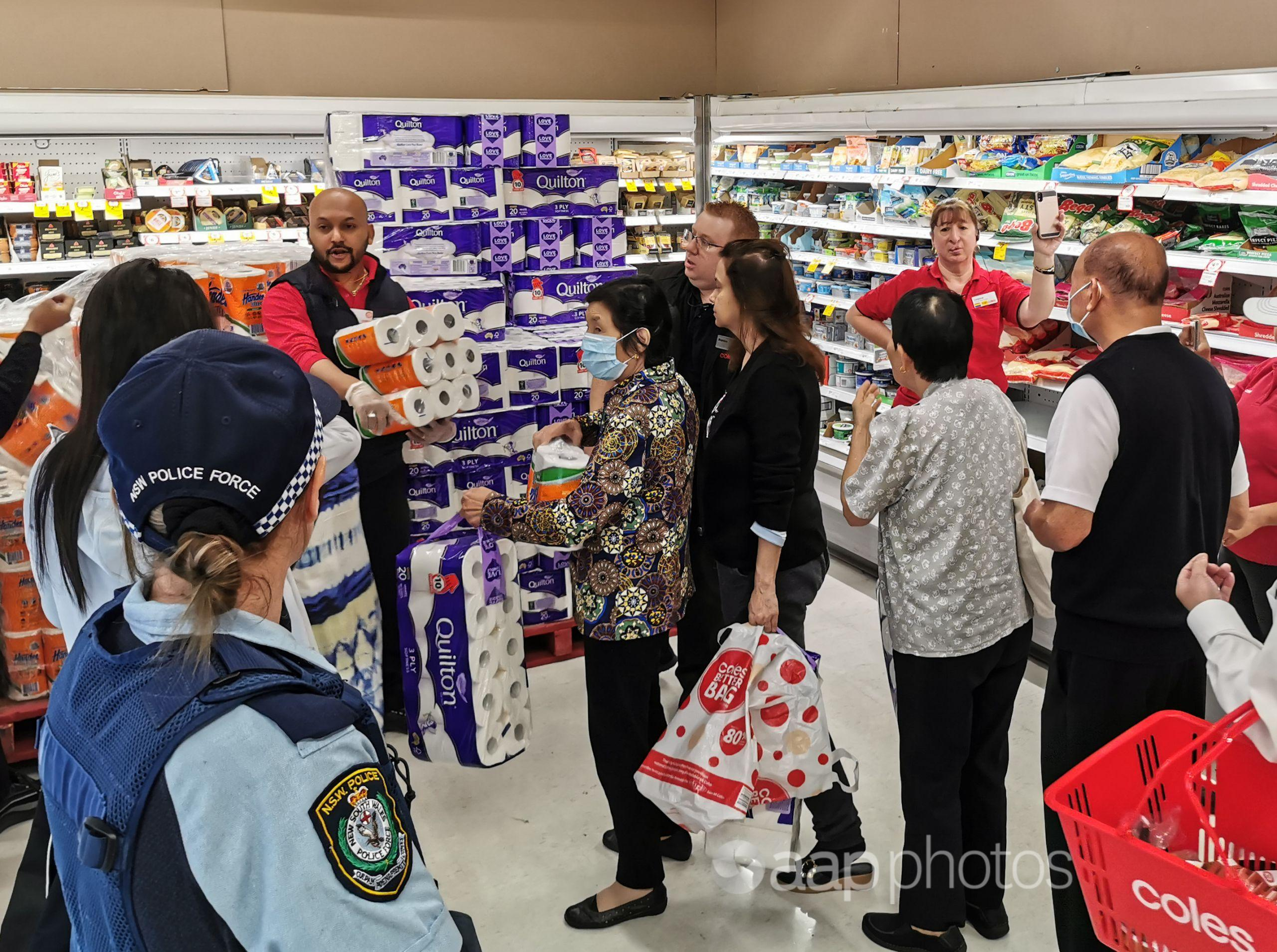 Police watch distribution of toilet paper and other basics.