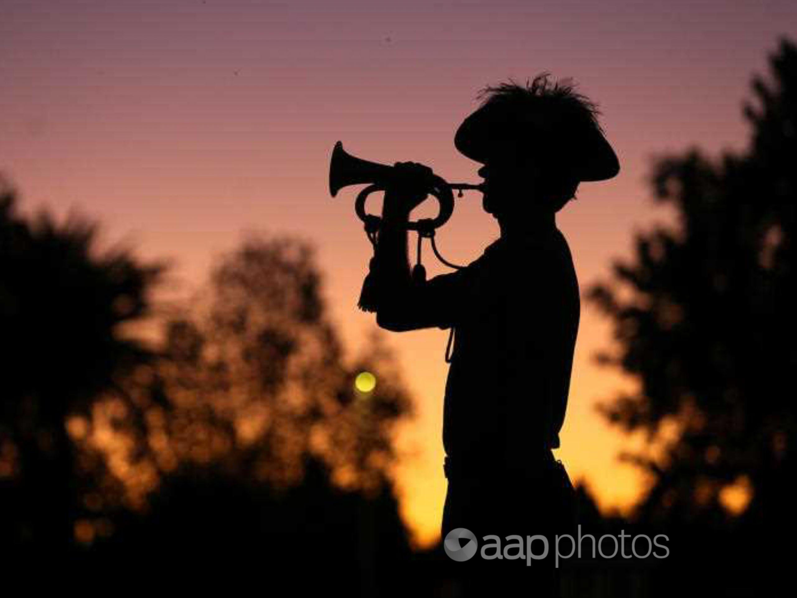 A bugler plays the Last Post