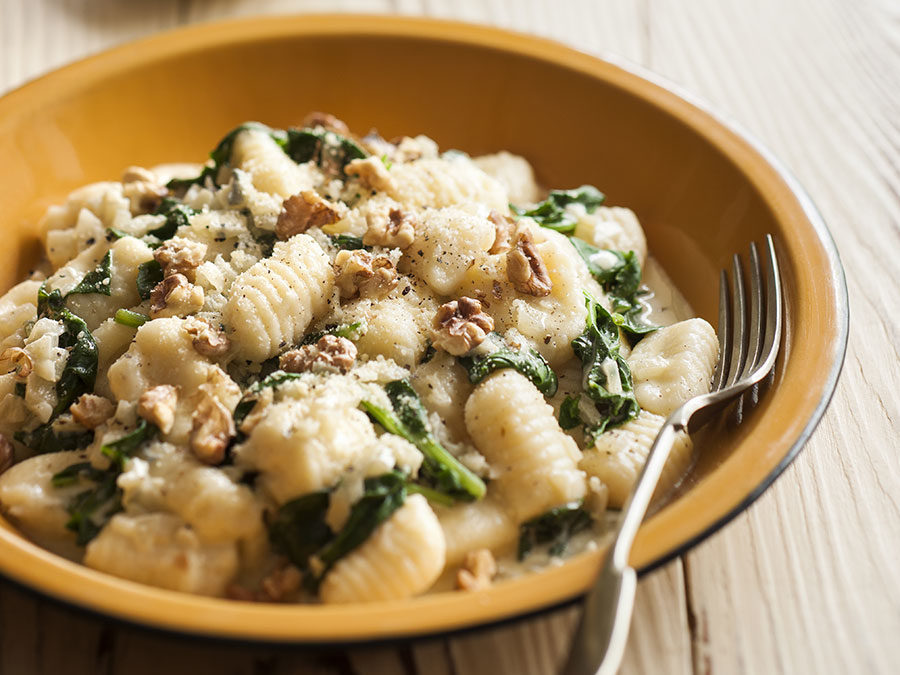 Potato and parmesan gnocchi with spinach, gorgonzola and toasted walnuts