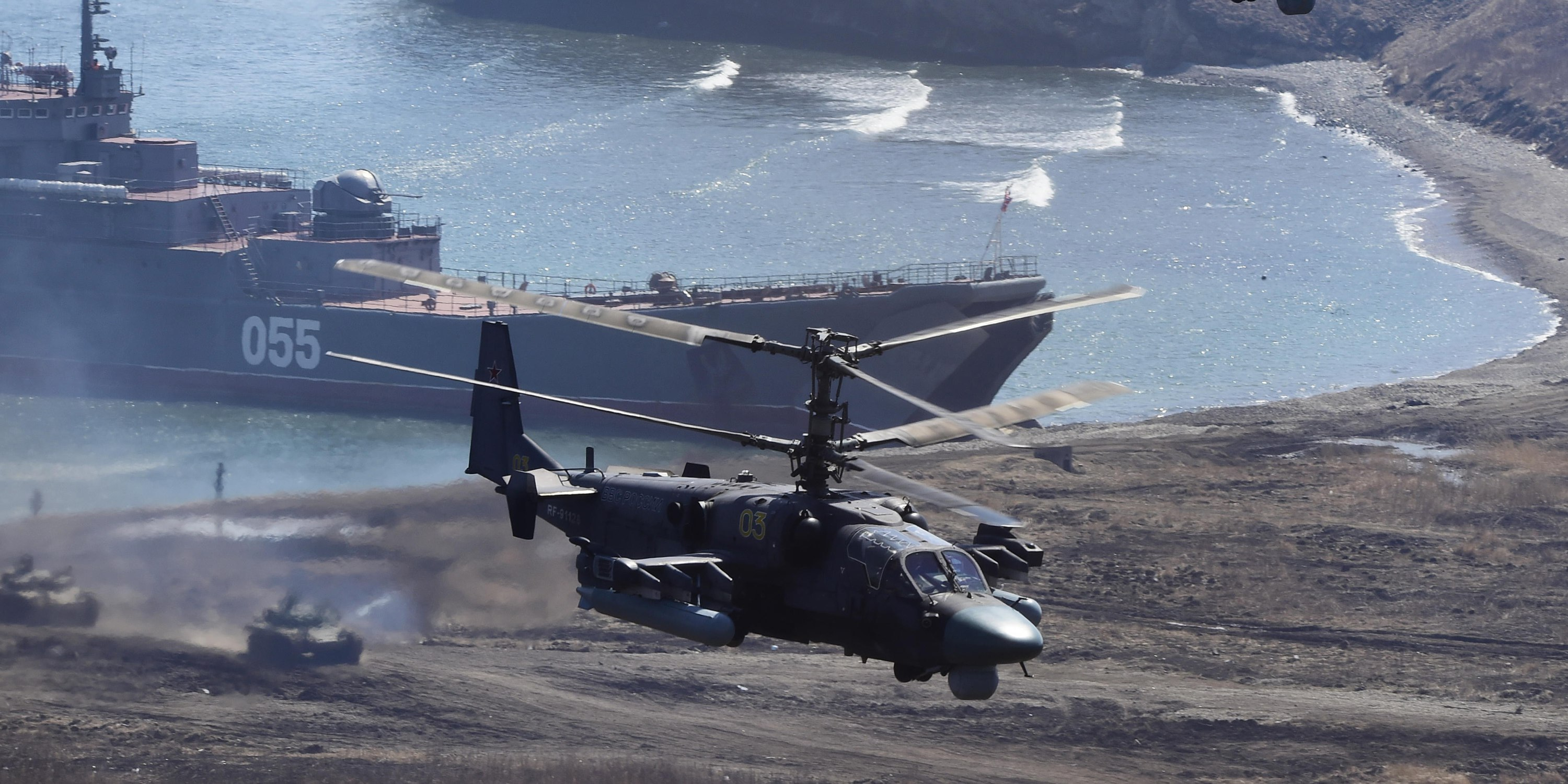 Kamov Ka-52 attack helicopters andT he Admiral Nevelskiy large landing ship take part in a military drill conducted by Russian Pacific Fleet's marine regiments and Russian Eastern Military District's mechanised infantry brigade at the Klerk range