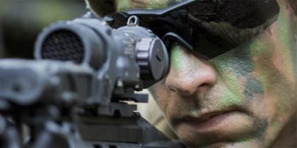 Australian soldier aiming weapon