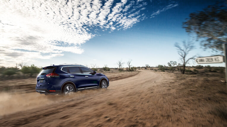 X-TRAIL shown in Marine Blue  Ti model with optional accessories.
