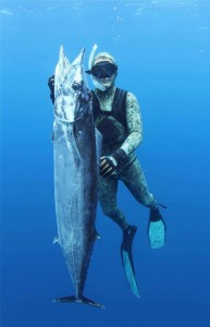 Pete Mau with a great 30kg Wahoo from New Caledonia. Photo by Travis Hogan.