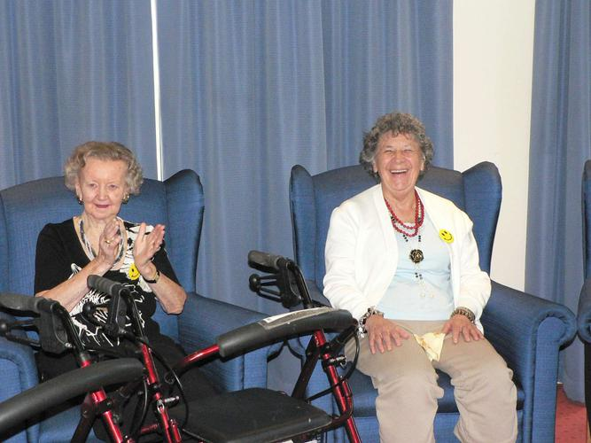 Melbourne aged care residents, Phyllis, left, and Rose, have a giggle as part of the trials.