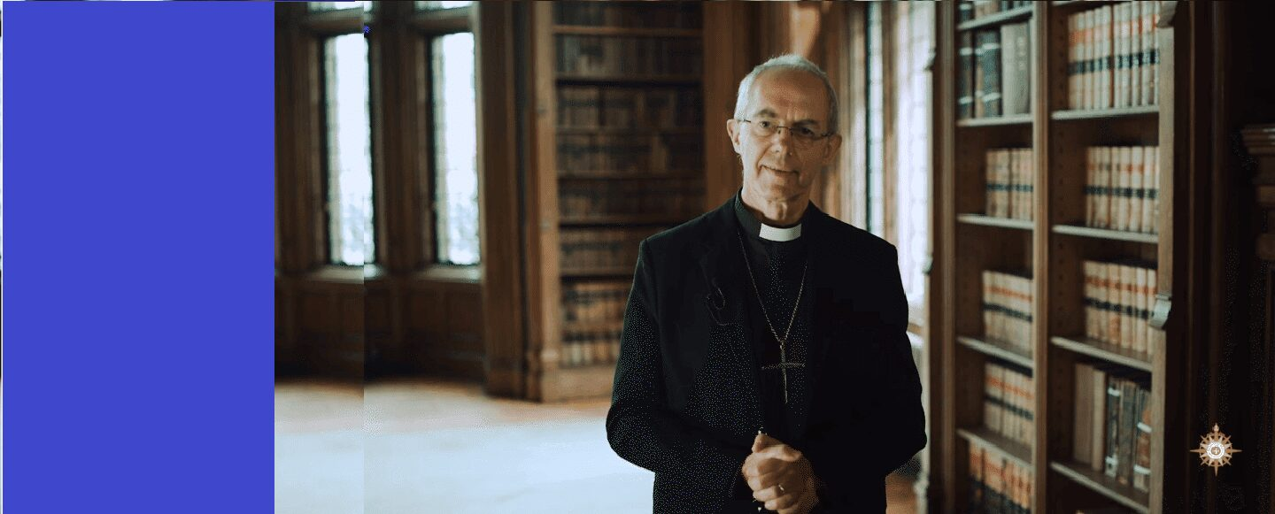 Archbishop of Canterbury standing in library
