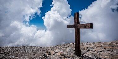 Easter cross clouds rock by Stefan Kunze