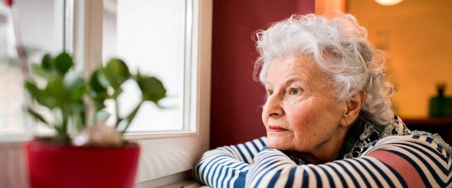 Elderly women loneliness looking out of window banner