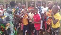 Eldoret Children receiving lollies at Christmas