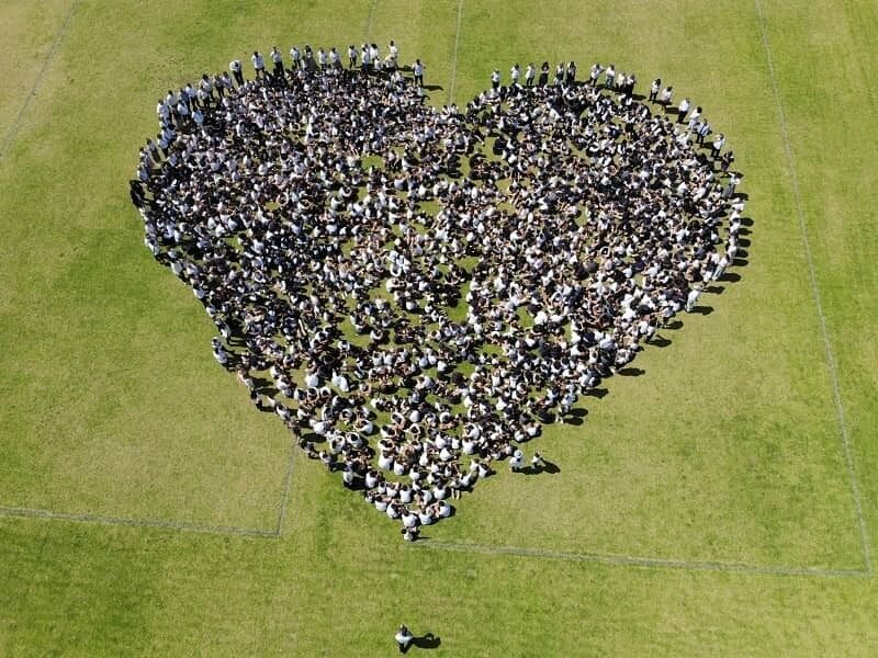 Swan Valley ACS Bullying is Never OK drone shot of students on oval in heart shape