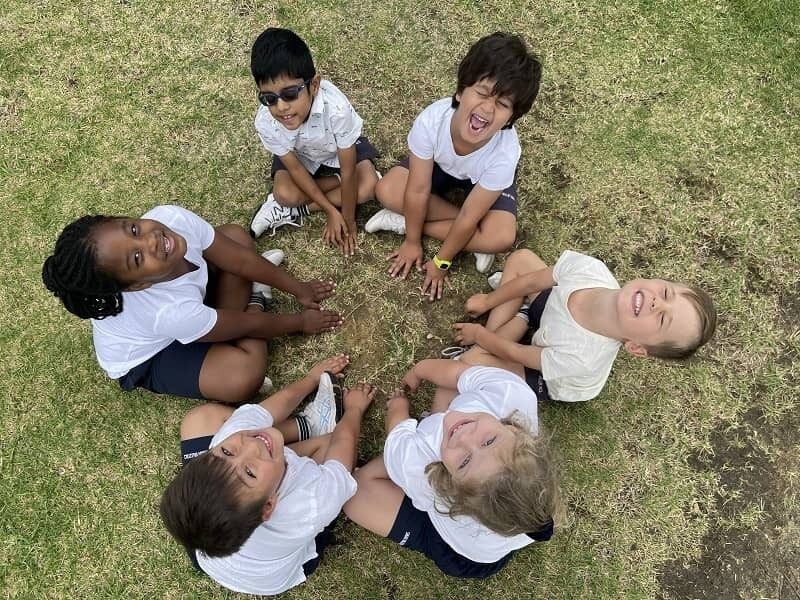 Swan Valley ACS Bullying is Never OK six junior students sitting on grass in a circle