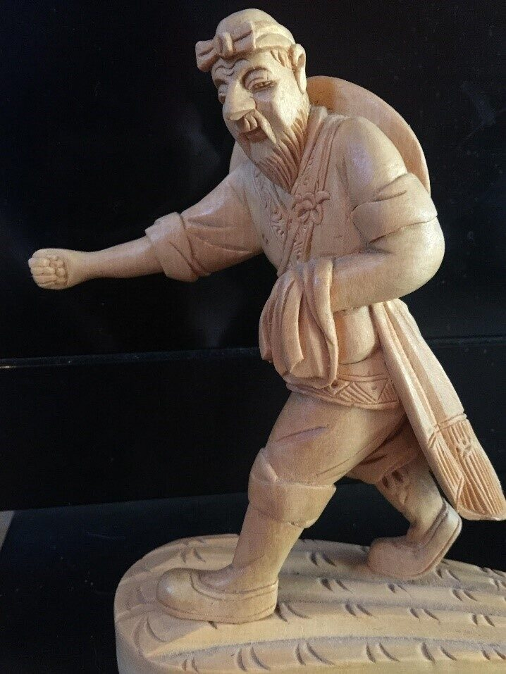 Statue of striding man