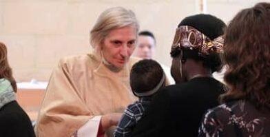 Archbishop Kay blessing families at Peter Moyes Anglican Community School thumbnail