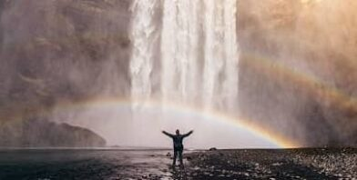 Person rainbow water freely by Jared Erondu thumbnail