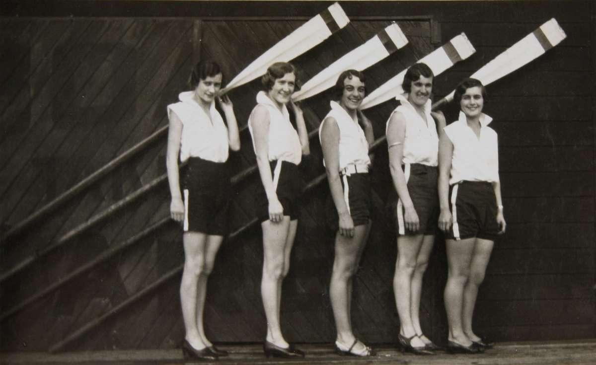 Crew of YWCA Four outside Gardner's Boatshed