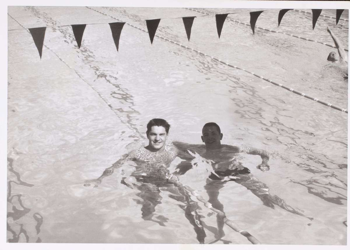 John Konrads with an unidentified swimmer