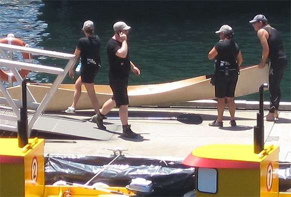Photo of canoe and production crew at pontoon