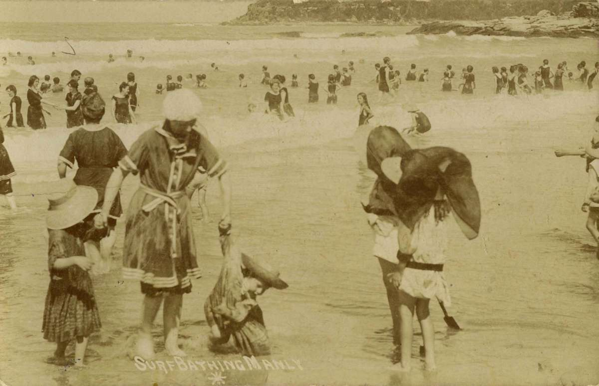 Photographic postcard titled: 'Surf bathing at Manly', c 1910. ANMM Collection 00004813