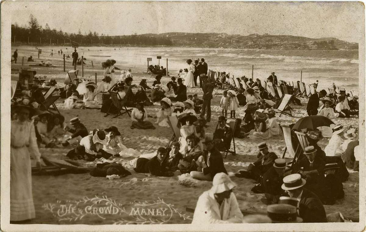 Photographic postcard of well-clothed beachgoers titled 'The Crowd, Manly', c 1890. ANMM Collection ANMS0519[017]