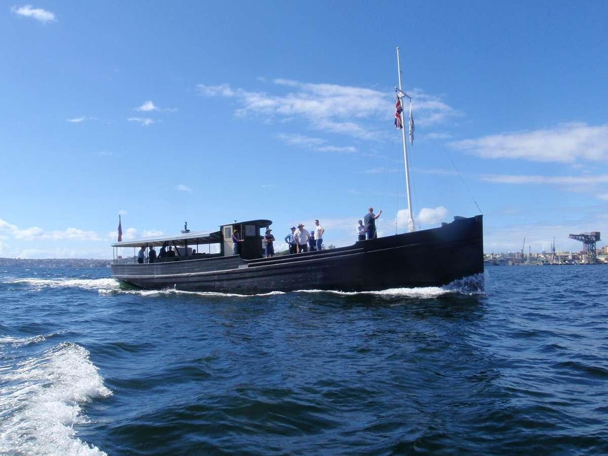 MV Krait passing Garden Island during a maintenance voyage, March 2013. ANMM Photo