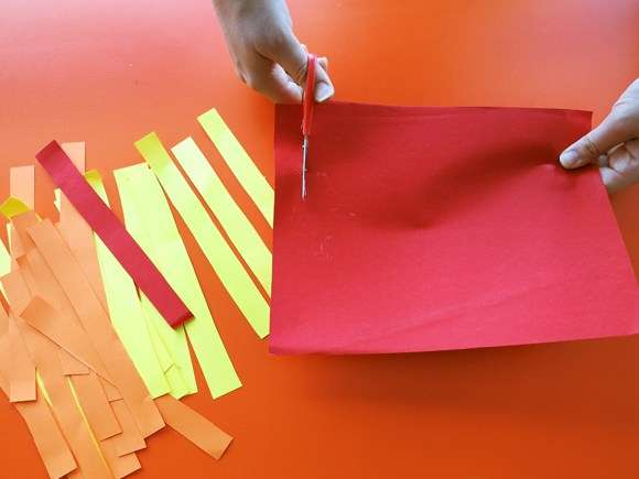 Step 2 cut coloured paper into strips