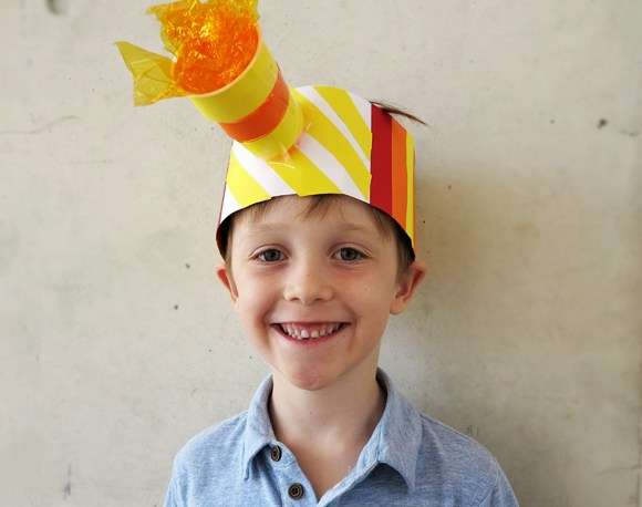 Boy wearing crafty rescue hat
