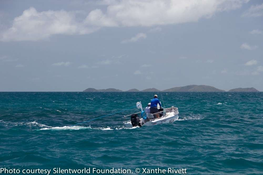 Photo of small boat with two men on board