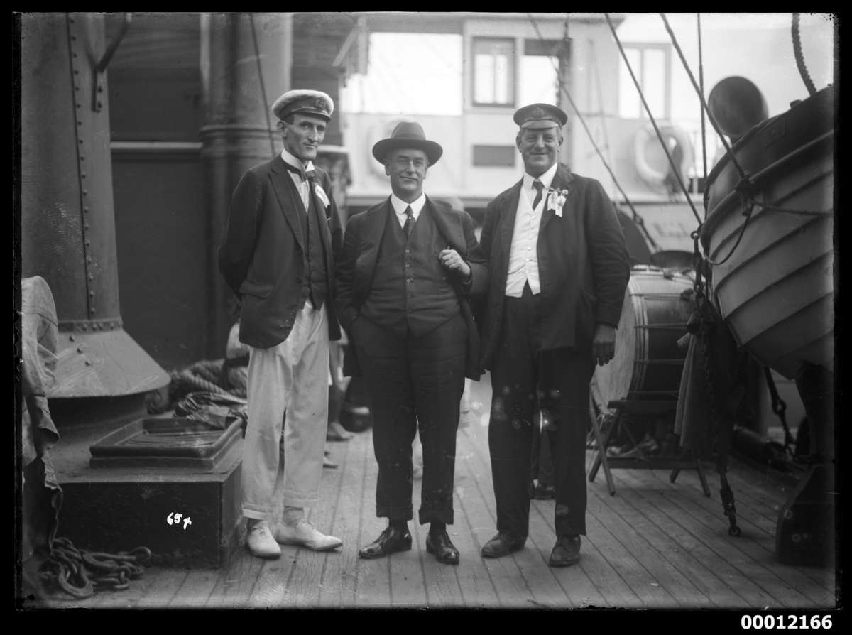 Mr John Roche (left), Mr F. J. S. Young (right) and an unidentified man onboard NAMOI, at the Pittwater Regatta. ANMM Collection 00012166
