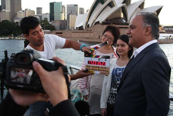 Indian Aussie Cruise Owner Sudhir Warrior with Japanese Aussie Indian family talking to film crew.