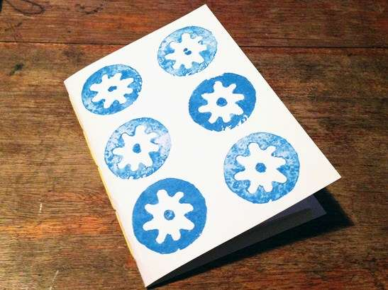 Paper notebook with blue potato print stamp cover
