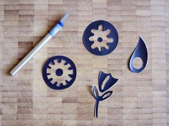 Cut out stencils of flower, rain drop and circles