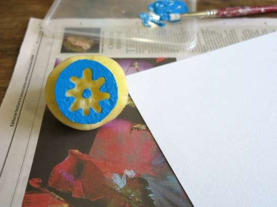 Potato stamp covered in blue paint