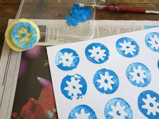 Blue potato stamp pattern on white paper