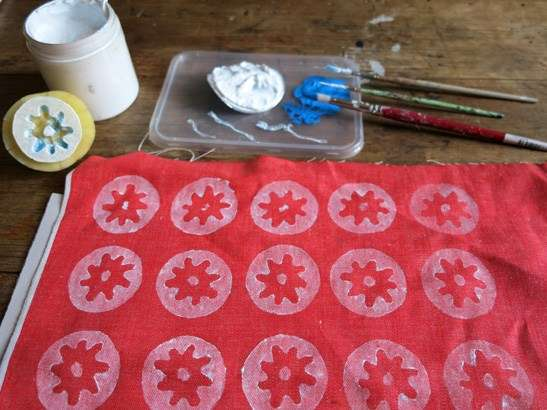 White potato stamp pattern on red fabric