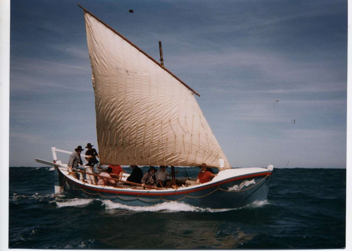 Boat with one sail at sea