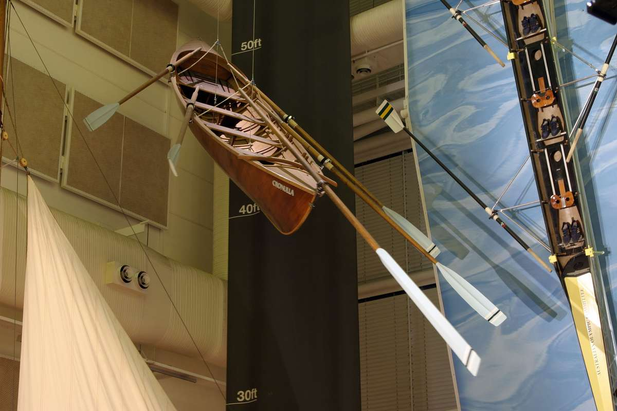 Wooden lifeboat hanging from ceiling