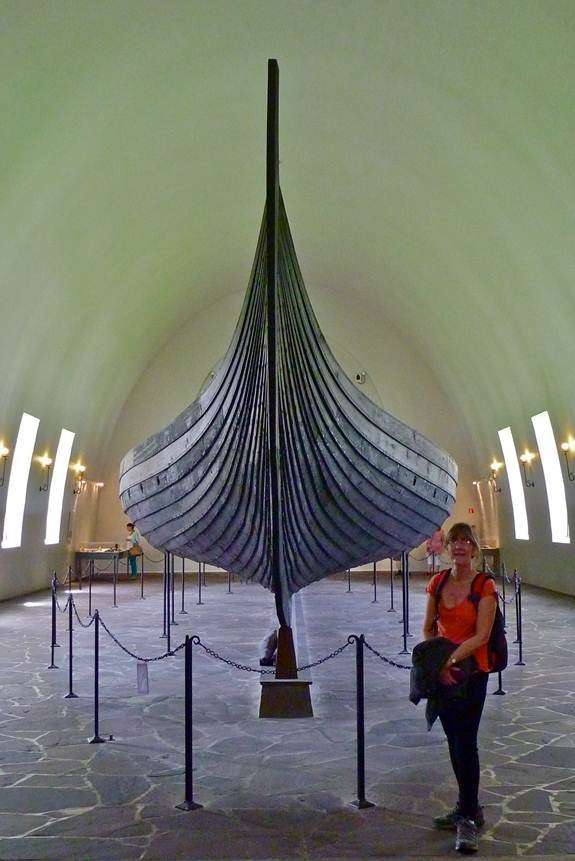 Clare Payne with the Gokstad find at the Viking Ship Museum in Oslo in 2013. Courtesy of  ANMM Curator David Payne.