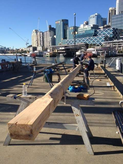 Led by Jeff Hodgson, Fleet staff prepare the mast