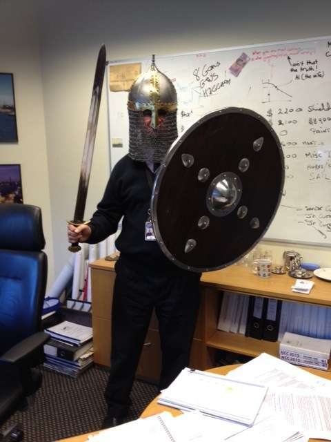 Man dressed as Viking in an office