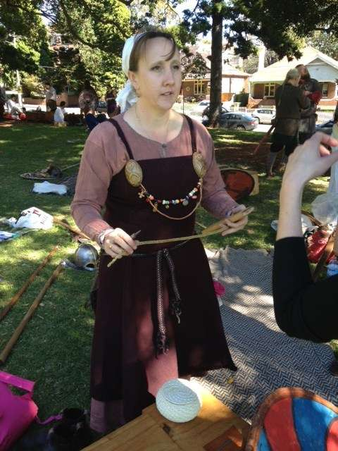 A Viking reenactor making wire jewlery